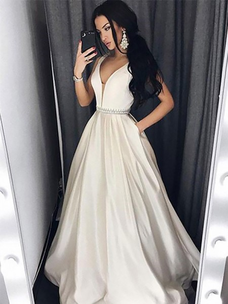 A-Line/Princess V-neck Sweep/Brush Train Beading Satin Dress